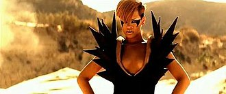 Hard (Rihanna song) - Rihanna in one of the many desert scenes, wearing a couture dress with spiked shoulder pads