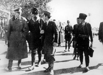 Pećanac Chetniks - Pećanac (second from left) with a German military officer and Kosovo Albanian collaborator Xhafer Deva (third from left) in Podujevo, Territory of the Military Commander in Serbia, 20 October 1941