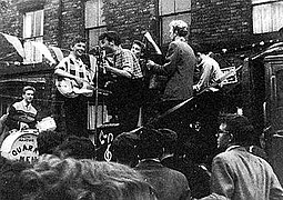 The Quarrymen performing in Rosebery Street, Liverpool on 22 June 1957[1] (Left to right: Hanton, Griffiths, Lennon, Garry, Shotton, and Davis)
