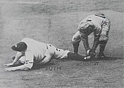 Cardinal second baseman Rogers Hornsby tagging out baserunner Babe Ruth who was trying to steal second, ending the 1926 World Series.