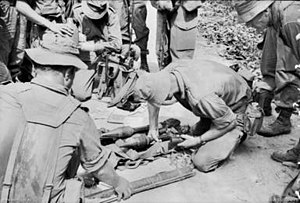 Battle of Suoi Bong Trang - Australian soldiers examining captured Viet Cong equipment during Operation Rolling Stone.