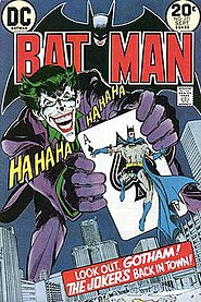 """Batman"" cover, with the Joker holding an ace of spades with Batman on it"