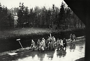 Death marches (Holocaust) - Dachau concentration camp inmates on a death march, April 1945, photographed walking through a German village, heading in the direction of Wolfratshausen, Bavaria.