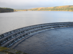 Image of a reservoir with water cascading on the overflow