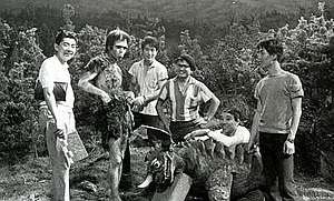 Frankenstein Conquers the World - Koji Furuhata (Frankenstein), Haruo Nakajima (Baragon), and some of the special effects crew take a break during filming on the set.