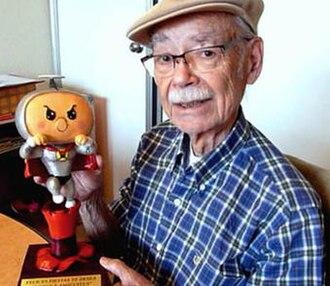 Manuel García Ferré - García Ferré with a Súper Hijitus action figure.