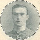 Faded photo of a clean-shaven white man wearing a knitted sports jersey