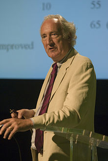 Colour photograph of Gordon McVie giving a lecture