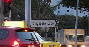 Singapore Expo - Road sign along Upper Changi Road East pointing to the exhibition halls.