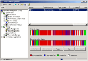 Windows 2000 - Windows 2000's Computer Management console can perform many system tasks. This image shows a disk defragmentation in progress.