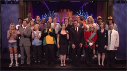 "The cast and special guests of the 30 Rock episode ""Live Show"" stand on the set of The Girlie Show with Tracy Jordan. From left to right: Katrina Bowden, Donald Glover, Jimmy Fallon, Grizz Chapman, Sue Galloway, Amy Poehler (front row), Daniel Genalo, Keith Powell, Tracy Morgan, Jon Lutz, Jack McBrayer, Tina Fey, Paul McCartney, Jon Hamm, Alec Baldwin, Scott Adsit, Kevin Brown, Will Forte (second row), Jane Krakowski, Judah Friedlander, Kristen Schaal, Chris Parnell (first row), and Fred Armisen"