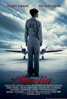Hilary Sas Amelia Earhart Standing Alone On The Runway With Her Back Turned Wearing A