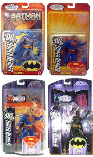 DC Superheroes (toys) - DC Superheroes Batman and Superman series in packages Left to right: Batman and Superman in orange (2006) package, and Superman and Batgirl in purple (2007) package