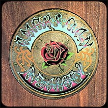"A woodgrain panel with a circle in the middle—inscribed is a rose surrounded by the words ""American Beauty"""