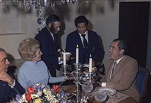 Manolo Sanchez (Nixon staff member) - Manolo Sanchez, third from left, presents Richard Nixon with a cake at his 61st birthday party in 1974 at the San Diego home of Walter Annenberg.