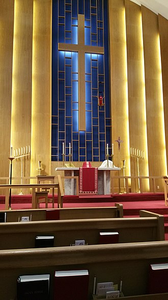Holy Week - The chancel of a Lutheran church decorated with red paraments, the liturgical colour of the last week of Lent, Holy Week, in Lutheran and Anglican Churches