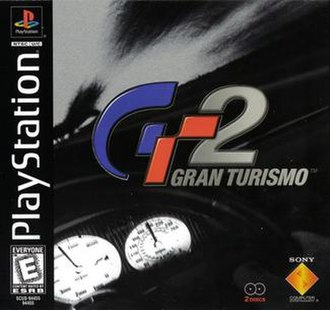 Gran Turismo 2 - North American cover art, featuring the dashboard of the McLaren F1