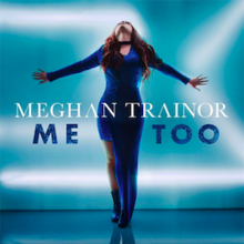 Meghan Trainor stands with her hands spread far apart while wearing a long, blue dress in front of a shiny blue background.