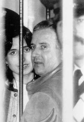 Raffaele Cutolo - Raffaele Cutolo beside his wife Immacolata between the bars at the Ascoli Piceno prison. c. 1982.