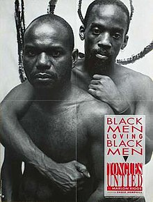 Black-and-white poster of two African-American shirtless men, whose faces express frown. The behind man wrapping one arm around the front man.