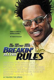 A man with Afro twists and a mustache is faced at the viewer with a man and a woman reflected on the lenses of his sunglasses. Beside him shows the title, film credits and rating.