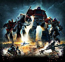 Poster showing Generation 1 (G1) Optimus Prime, G1 Megatron, G1 Starscream, and movie versions of Sideswipe, Jetfire and Soundwave. Four robots are oversized for the poster, and are shown over an Egyptian city. Below Soundwave is shown in both robot and vehicle modes on the left, while Jazz and Jetfire are shown in robot mode on the right.