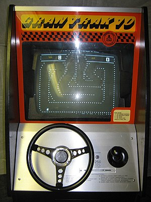 Gran Trak 10 - Photograph of a running Gran Trak 10 cabinet; time has run out with the player at 8 points. The steering wheel, gear stick, and scoring placard are visible, as are instructions to the player