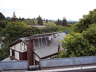 Solar panel - Image: PV solar installers on sloped roof