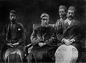 Samaritan High Priest - Family of the Samaritan High Priests, 1876. To the left is a scribe named Shalabi, to the right are Isaac the son of the High Priest Amram ben Shalma, then Abisha, the son of Amram's brother Pinehas, and finally Uzzi the son of the High Priest Yaacob ben Aaharon ben Shalma, the son of Amram's brother Aaharon.