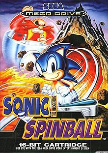The game's European cover art. The artwork shows Sonic the Hedgehog running in the foreground, while series antagonist Doctor Robotnik is angrily chasing him on a floating pod. The background shows the volcanic Mt Mobius erupting. Pinball flippers can be seen at the bottom.