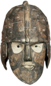 Colour photograph, taken from the front against a white background, of the first reconstruction of the Sutton hoo helmet.