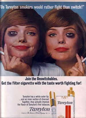 """Us Tareyton smokers would rather fight than switch! - A Tareyton magazine advertisement from 1965. In the famous campaign, people from all walks of life (in this example, two red-haired sisters) donned """"black eyes"""" to demonstrate their willingness to """"fight"""" instead of """"switch"""" from the Tareyton brand."""