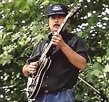 "Babik Reinhardt (musician) at Samois, 1990 (still from John Jeremy film ""The Django Legacy"").jpg"