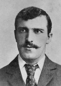 A man wearing a jacket and tie.