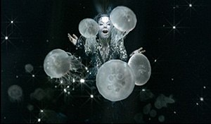 "Oceania (song) - Björk as ""Mother Oceania"" in the music video, wearing tiny crystal beads on her face"
