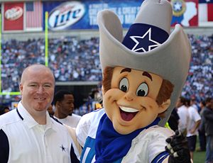 Rowdy (Dallas Cowboys) - Rowdy with a fan during a 2008 game.