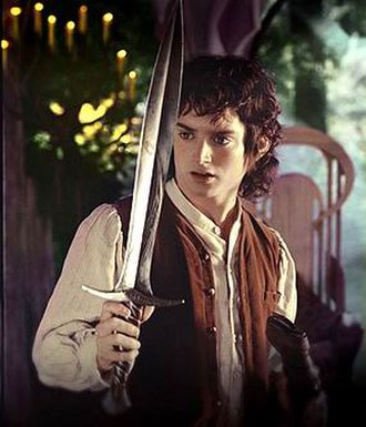 Sting (Middle-earth) - Elijah Wood as Frodo, holding Sting, in The Lord of the Rings film trilogy