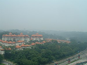 2006 Southeast Asian haze - Overlooking the Perdana Lake Gardens in Kuala Lumpur at noon of 16 October 2006. The API read 76 at 11 AM. On a clear day, the Parliament and the National Monument would be visible on the horizon.