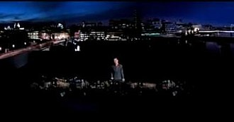 "The Climb (song) - McElderry performing in a flooded cityscape in ""The Climb"" music video"