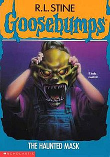 Cover of the book, showing a girl holding a green Halloween mask over her face