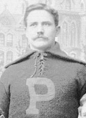 Wylie Glidden Woodruff on his football uniform and sporting a mustache in his 1893 Penn football photo.