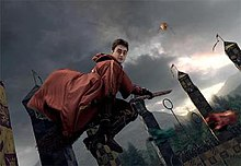 A scene from the film that accompanies the ride which features Harry Potter as portrayed by Daniel Radcliffe riding a broomstick.