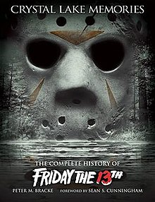 "A modified goalie mask sits in the foreground, with a split on the top right (viewer perspective) corner of the mask. Through the eye holes an image of a lake and boat dock can be seen, shaded in a red tone. A small boy stands on the dock. The words ""Friday the 13th: From Crystal Lake to Manhattan - Ultimate Edition DVD Collection"" appear in the bottom right corner of the image."