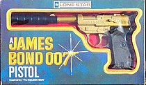 A toy pistol, in gold, with a black silencer: the item is still in a box