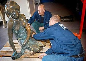 The Little Mermaid (statue) - Police technicians examine the damage to the statue after being blasted off its base the day of September 10, 2003.
