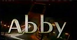 "An image with the words ""Abby"" against a dark backdrop with lights."