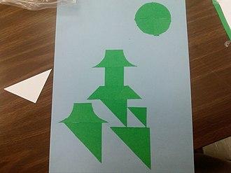 Tiling puzzle - Example of a tiling puzzle that utilizes negative space.