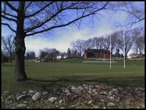 Appleby College - A view of Appleby College's Creek Field at the southern end of the campus. Powell's House and Colley House can be seen in the distance and the Appleby College Forest is shown on the left.