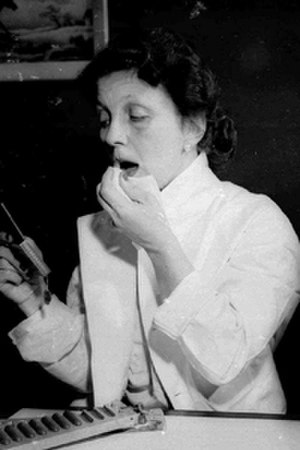 Hazel Bishop - Bishop applying lipstick, 1951