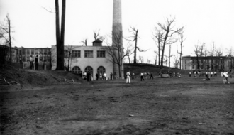 Rockwell Field (Kent State) - Baseball game or practice at Rockwell in the 1930s. Merrill Hall, the original heating plant, and Lowry Hall can be seen in the background